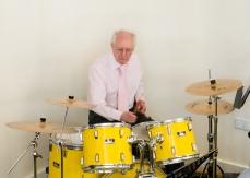 Playing the drums during Morning Worship